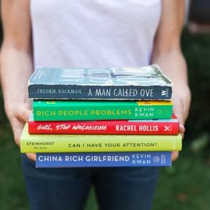 5%20ways%20to%20start%20reading%20more_woman%20holding%20stack%20of%20books-300?v=1