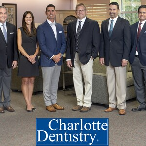 charlotte%20dentistry%20group%20photo%20with%20logo%201-300?v=1