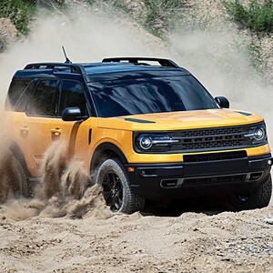 br%202021%20-%202021%20ford%20bronco%20sport%20yellow%20front%20view%20driving%20in%20dirt-300?v=1