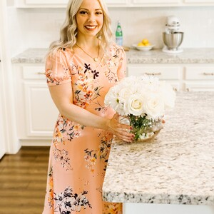 becca%20in%20the%20kitchen%20with%20flowers-300?v=1